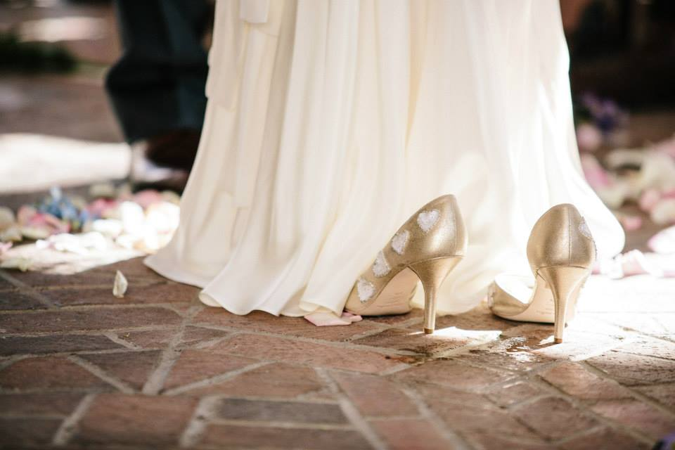 snapshot: our wedding photographer caught me slipping off my shoes mid-ceremony.
