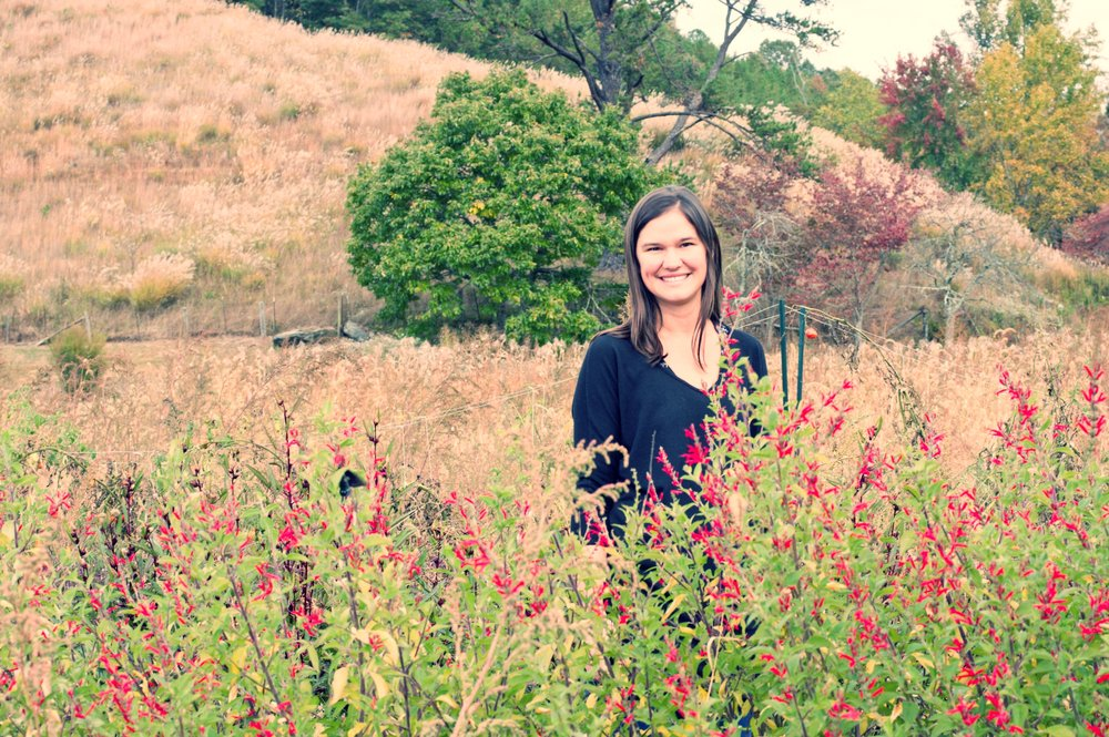 Owner Jessie Dean at Rayburn Farm in a field of pineapple sage flowers, used in a seasonal blend. Photo by Cindy Kunst
