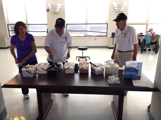 Serving ice cream at the TorC Veterans home