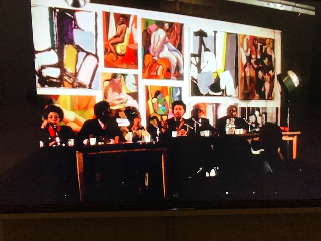 """The Black Artist"" panel at the Art Students League, New York, March 2, 1971, from  Black Artists in America,  a film by Oakley N. Holmes, Jr.  (from left: Vivian Browne, Edmund B. Gaither, Faith Ringgold, Benny Andrews, Hale Woodruff, Alvin Hollingsworth)"