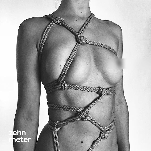 I usually love minimalistic and symmetric ropework but I want to get into more freestyled and asymmetric ropework as well. I had a lot of fun doing it and I'm going to experiment with it more in the future. — Ropework & Photography: @zehn.meter  Model: Does not want to be named. Rope: @learn.shibari