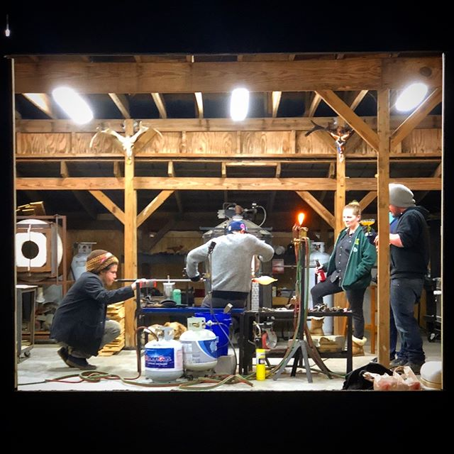 Dragon Ranch TV 📺, featuring @daybydayglass @benyosefglass @egonglass @garmezyglass  Photo by @gulleted  We took our giant steel window out of the sliding barn door for repainting and replacing broken panes, which just so happened to make for a great shot of the guys at work 📸  #glasstv #glasslife #glassblowing #glassstudio #artistsatwork #glassblower #garmezyglass #dragonranch