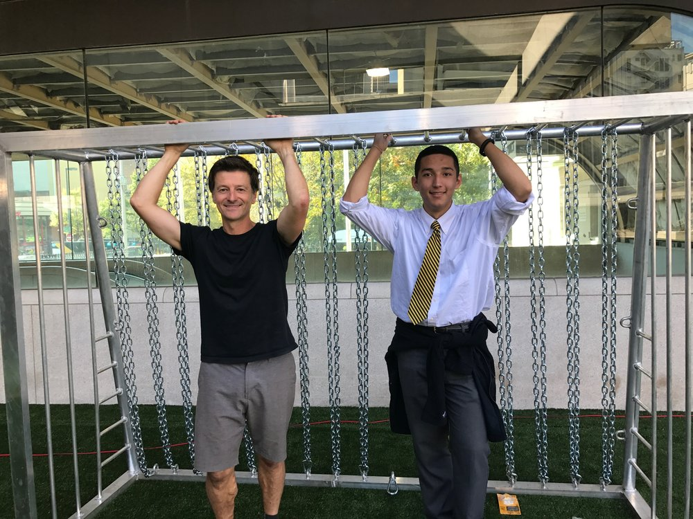 Phil Hill (left) with Nicolas Mejia (right) setting up the goals at 'Station Soccer'