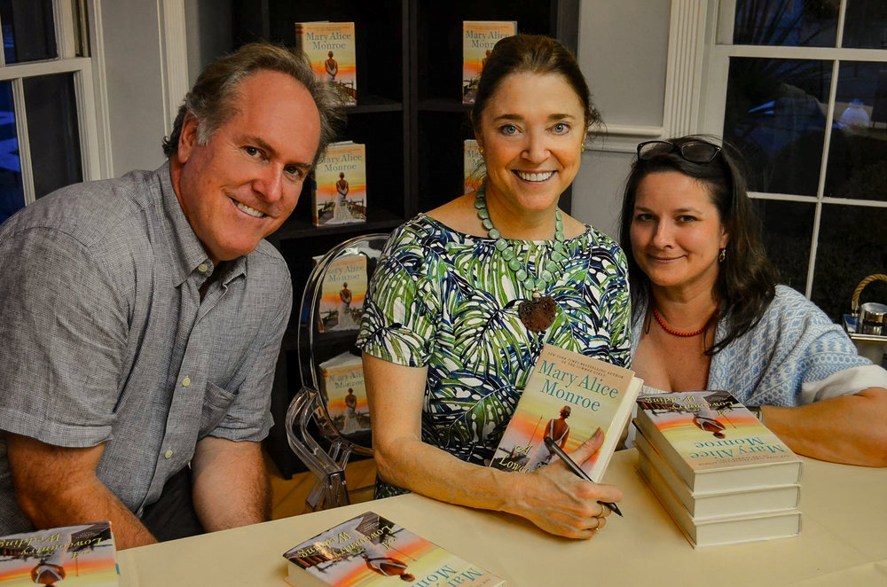 Mary Alice Monroe in store meeting fans and personalizing copies of A Lowcountry Wedding