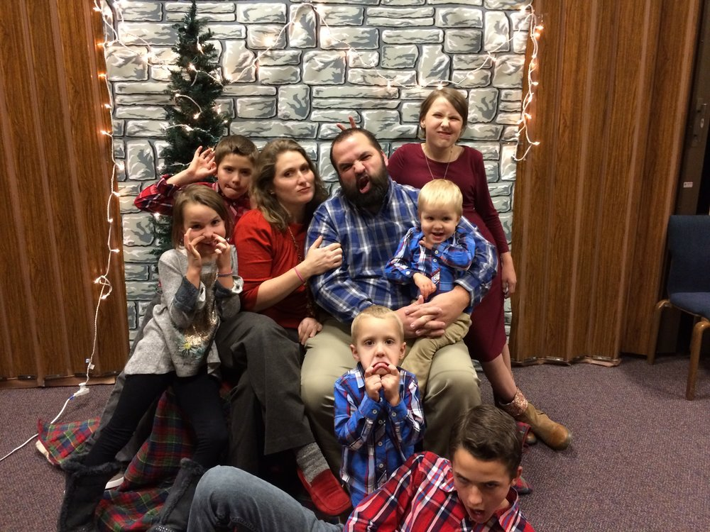 We tried to grab a quick family picture at our church Christmas party. This was the best one we got! Does show how crazy Team Thomas really is! :D