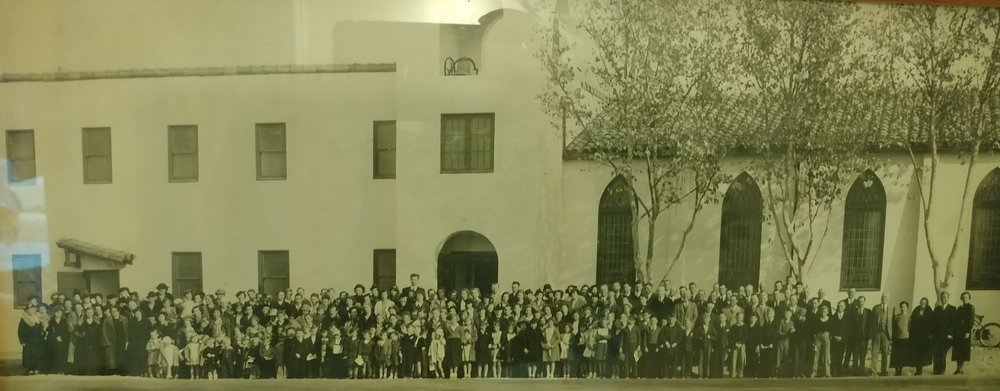Our church building with members from the 1st Baptist Church, many years ago.