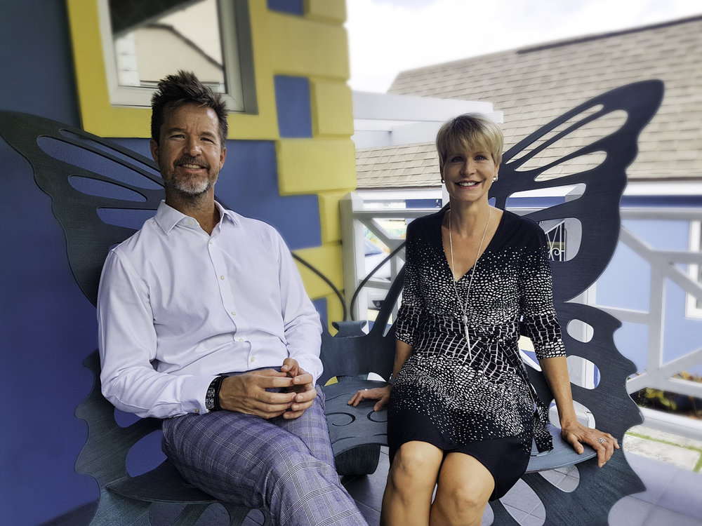 """Shawn M. Sawyer and Saskia D""""Aguilar perched on the porch of the D'Aguilar Art Foundation (DAF)."""
