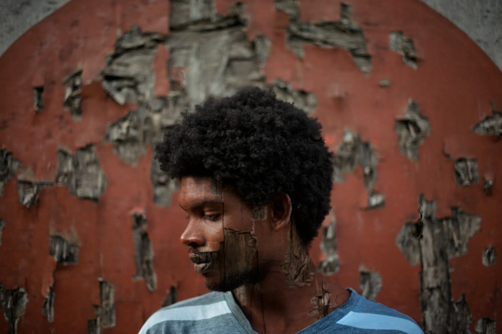 "Photographer Delton Barrett pushing the boundaries of Bahamian art with his first solo show. This self portrait is entitled ""Symmetry with Flaws."""