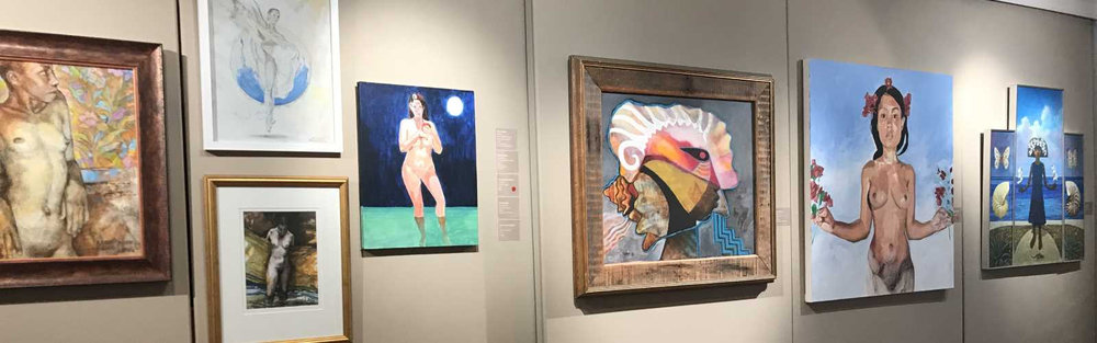 A collection of paintings from the MUSE exhibit featuring works by Brent Malone and Allan Wallace. Photo courtesy of the DAF.