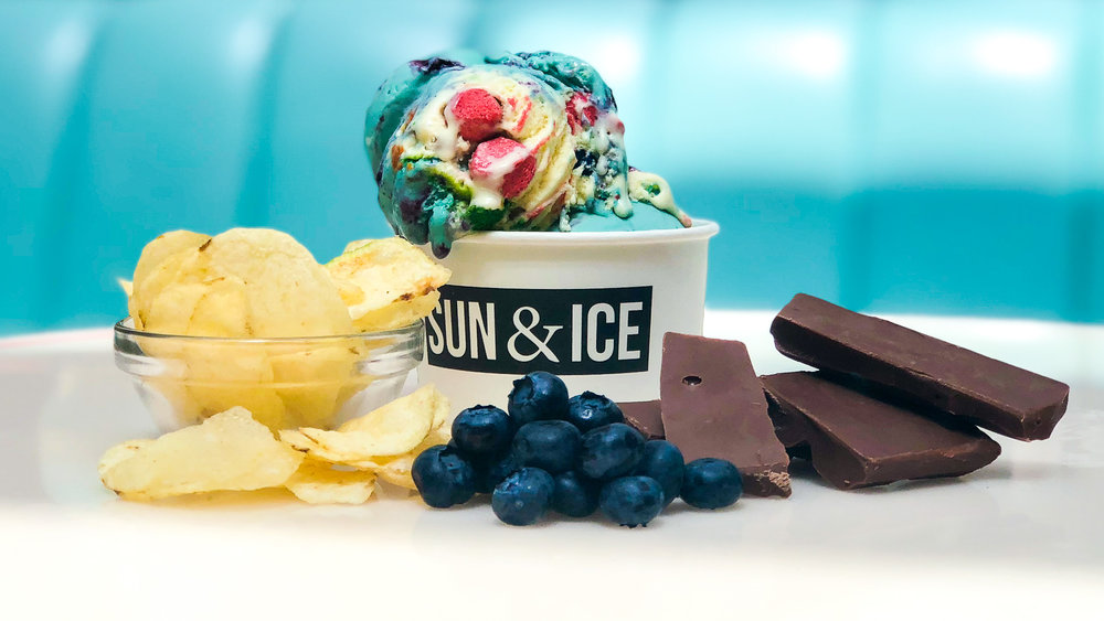 THE   JUNGALISS  -   a colorful spin on Bahamian slang used to refer to a gaudily-dressed woman with a rambunctious demeanor. The ingredients reflect the colorful nature of a Jungaliss through its unusual combination of Blueberry Mistic, Chocolate Dipped Potato Chips, Cookie Dough and Caramel Pearls.