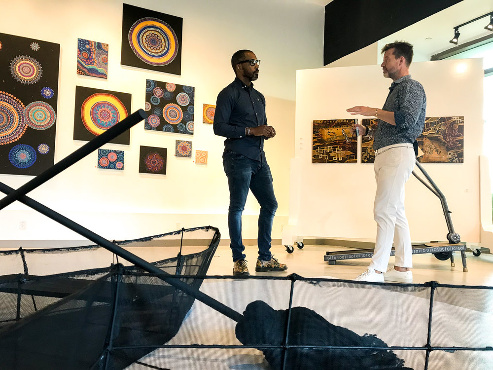 John Cox and Shawn M. Sawyer begin their tour in the main modular gallery space used to host events, talks and other cultural happenings.