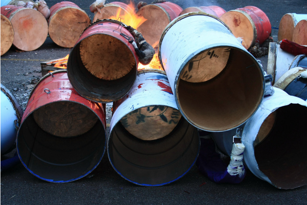 Warming of the drums. Photo by Theo McLain.