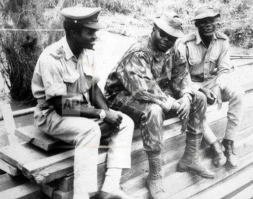 Murtala Mohammed with two unnamed officials