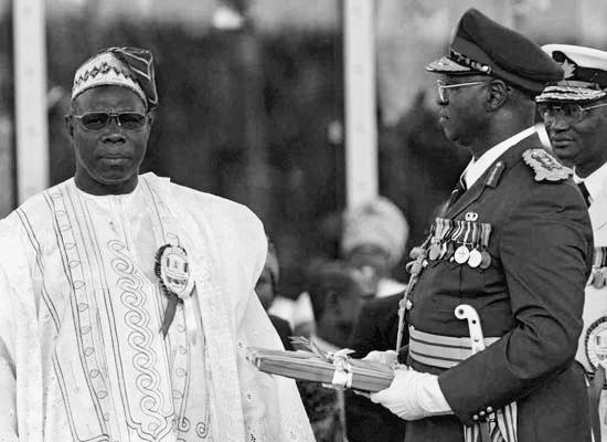 Abubakar transfers leadership of Nigeria to civilian president Obasanjo.