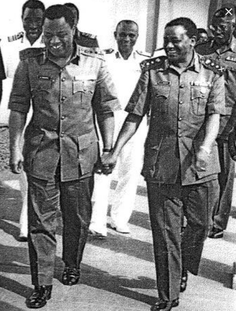 Babangida And Abacha Holding Hands.