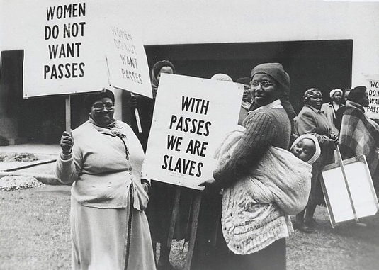 "On this day, in 1956, thousands of women in South Africa took to the streets to protest the Pass Laws—repressive laws that required black/African women (the law had initially applied to just African men) in Apartheid South Africa to carry reference books, in order to be permitted in any urban area, or, face trial.  _  Led by Sophie De Bruyn, Helen Joseph, Lillian Ngoyi and Amina Cachalia (swipe left) and organised by the Federation Of South African Women (FSAW), women marched to the Union Buildings in Pretoria with a petition against the inhumane laws (see 3rd picture) and oppression. Across the country, women (1st picture was taken in Cape Town) united to use their collective voice.  _  This day, since 1995, is thus recognised and celebrated as the South African #WomensDay; symbolising the strength of South African women. It remains a clear and crisp reminder of the phrase ""wathint' abafazi, wathint' imbokodo"" — that is, if you strike a woman, you strike a rock! ✊🏾 