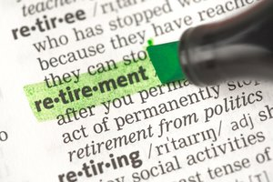 Financial advice graphic. Highlighting the word retirement in a dictionary.