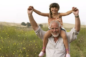 A grandfather and granddaughter. Good financial advice can take the stress out of retirement.