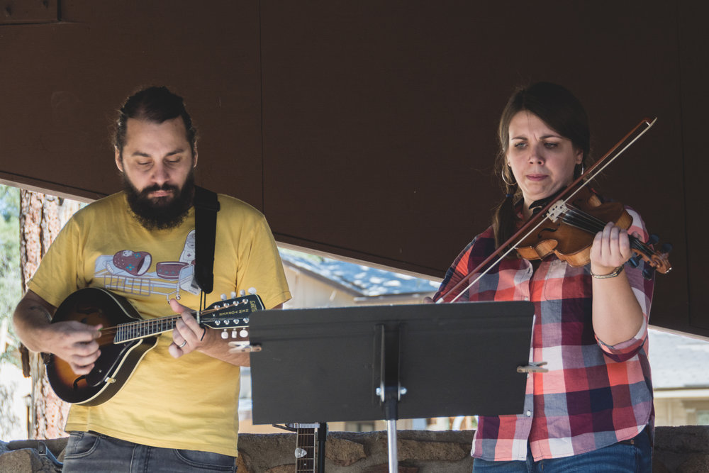 Josh pretends he knows how to mandolin alongside TMC's new teaching pastor, Meghan Good, at the fall church retreat.