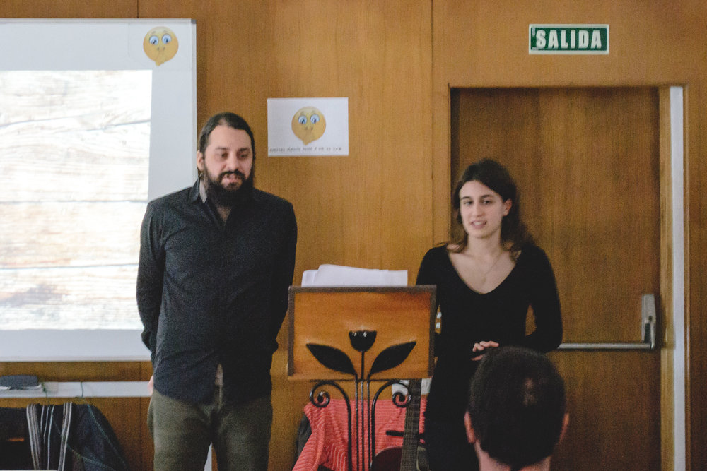 Josh bringing a message of hope to the church in Barcelona with translation aid from Ester, a youth in the church.