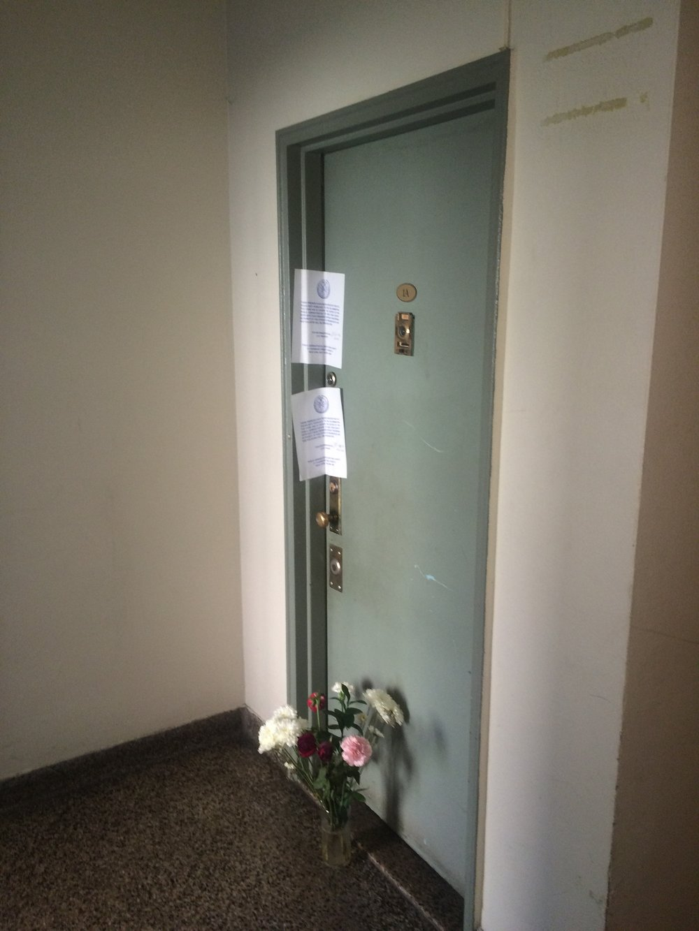 "It's been over two years since the lady downstairs ""burned out,"" in the words of Manny The Super.  Her apartment is still sealed by City Marshals and someone keeps putting plastic flowers at the door. I hate living in New York City."
