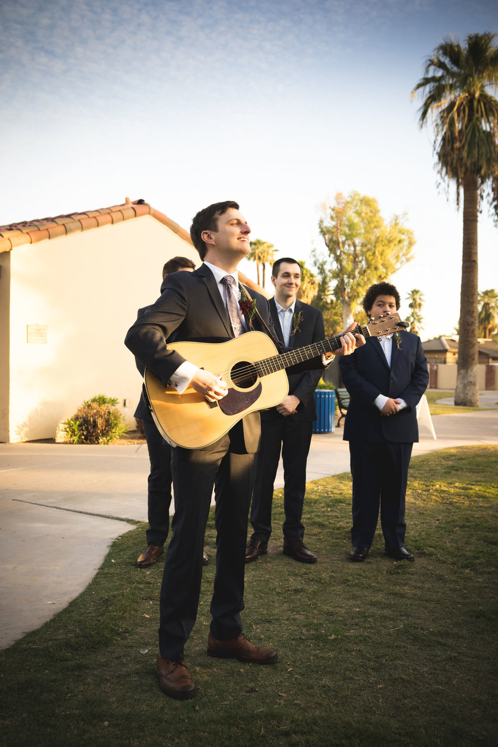 singing groom down the aisle wedding ceremony ideas cute musician groomsman