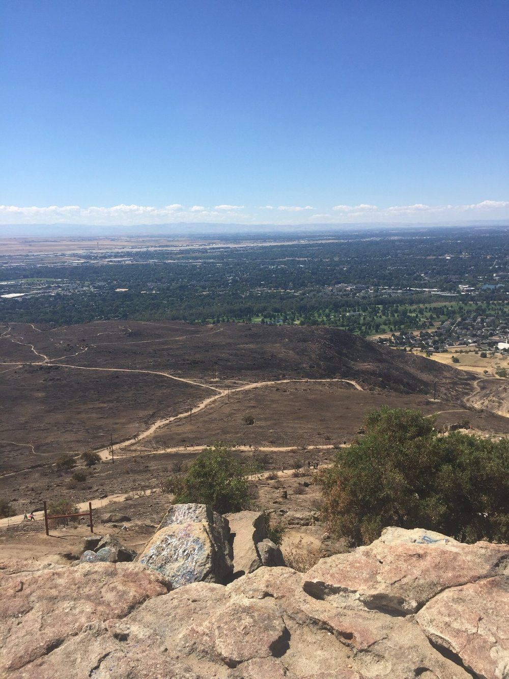 Some of the burned area from the recent fire. View from the top of Table Rock. Boise down below.
