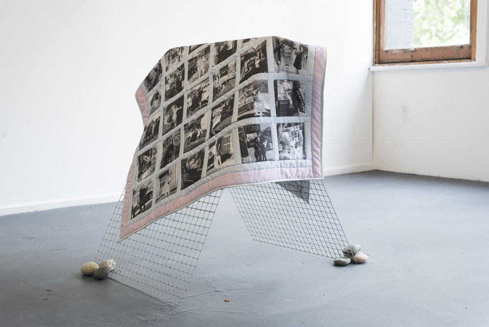 Aaron Claringbold  Absolve my quilt  First home buyers baby quilt; found images printed on cotton, South Australian wool, Chinese steel support, assorted Chinese Tuscan River Rocks 101 x 113 cm, dimensions variable  2018  Photo by Aaron Claringbold