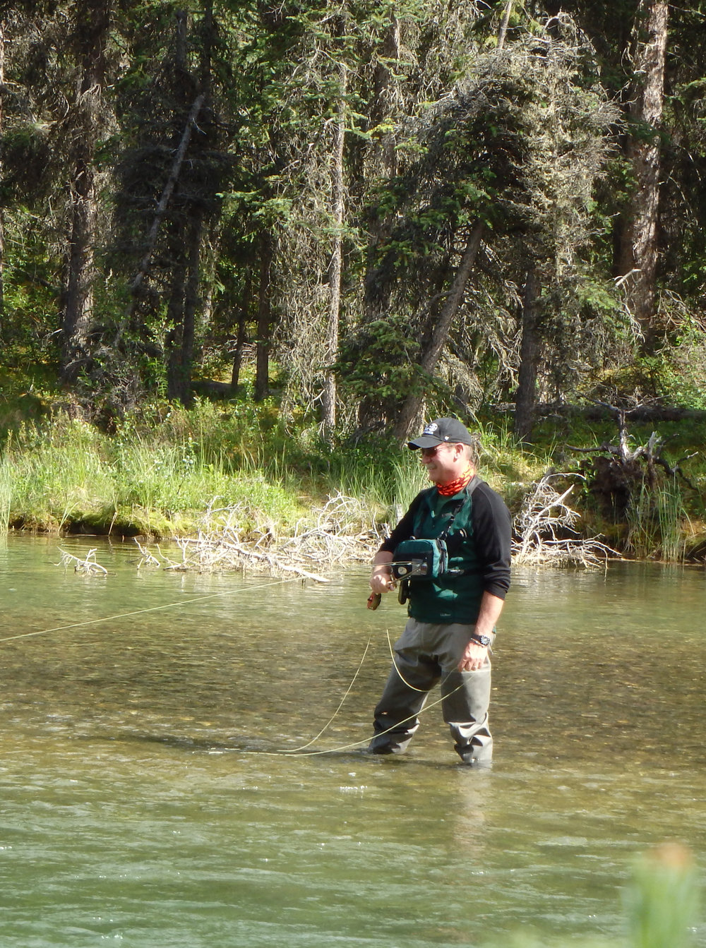 Enjoying the moment, fly fishing a remote mountain stream