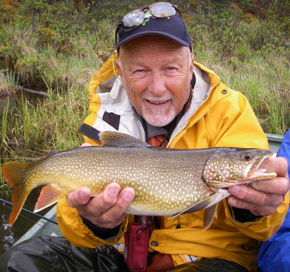 Norm with Lake Trout at S. Gataga.jpg