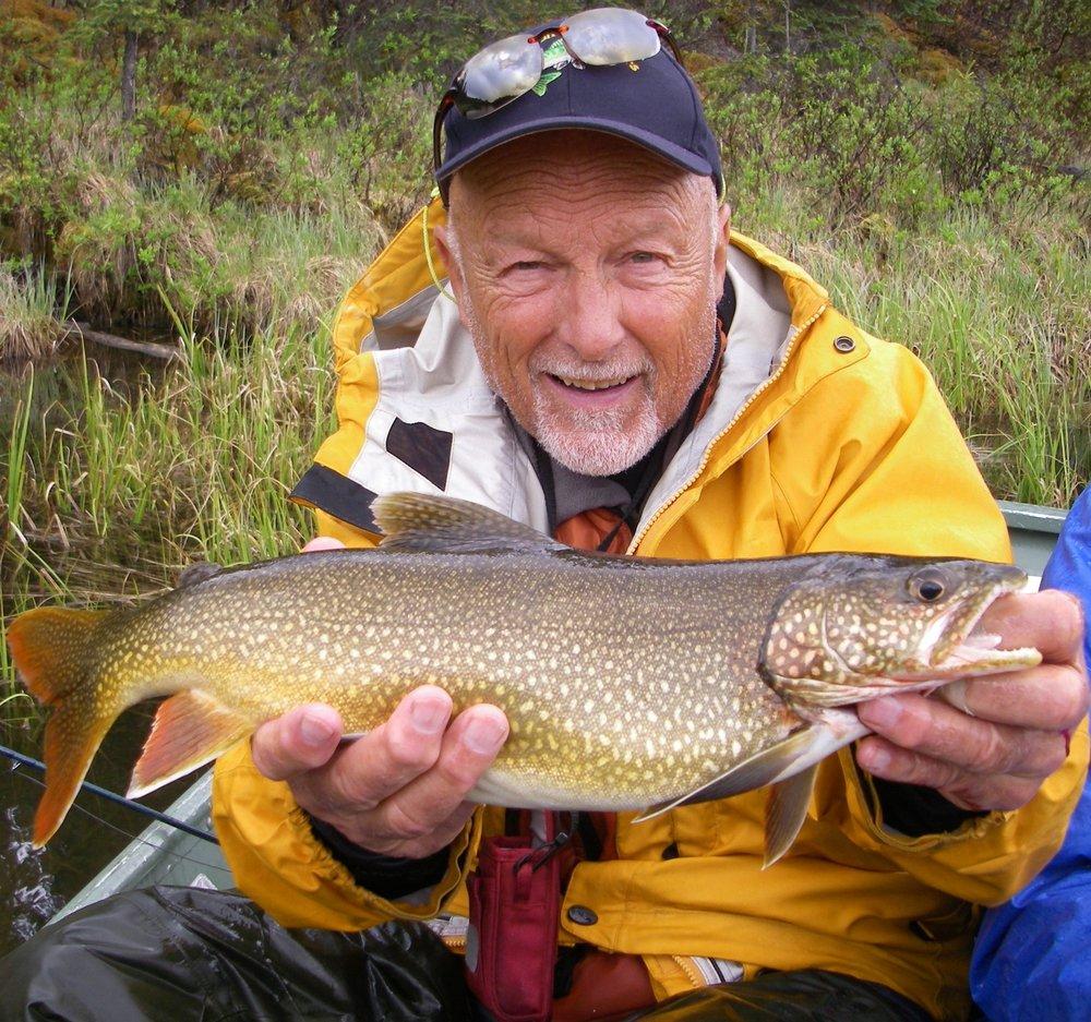 Norm with Lake Trout at S. Gataga.jpg