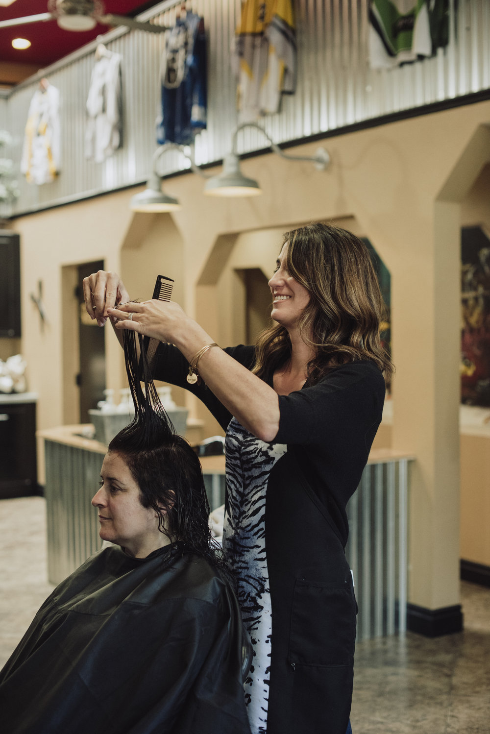 Lynn T. finishing a color and haircut