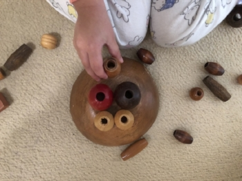 """What do you get when you combine boredom, beads and a bowl? A """"piggy face"""", of course!!"""