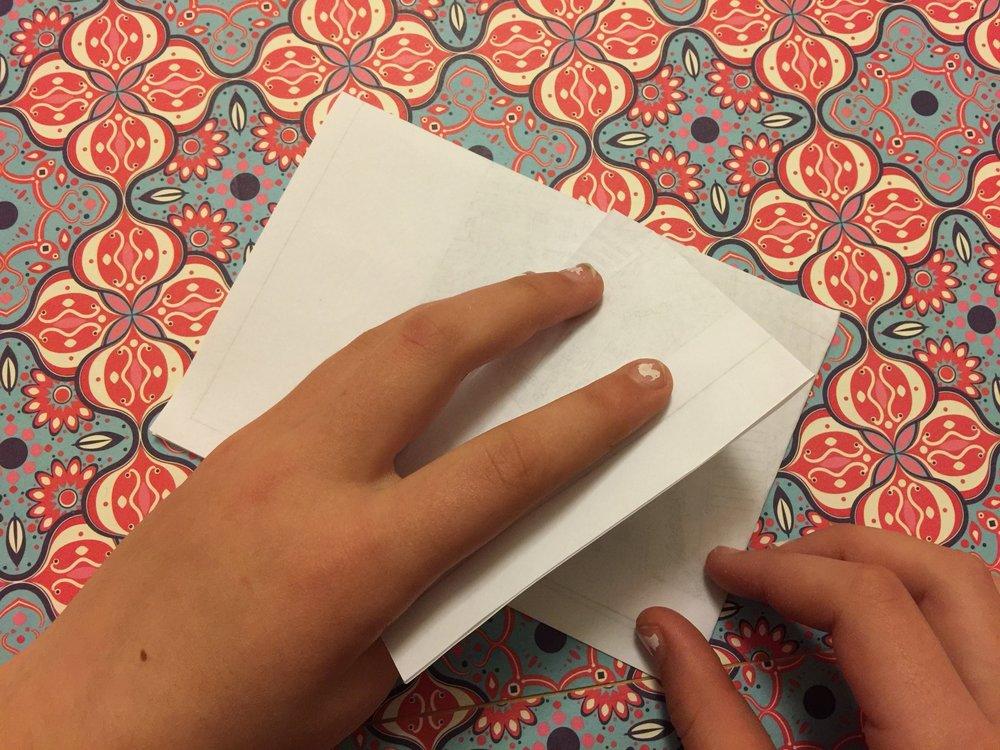 Fold back the outside corner on one side…