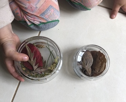 "Coffee jar lids make a great ""mini treasure case"" for little hands"
