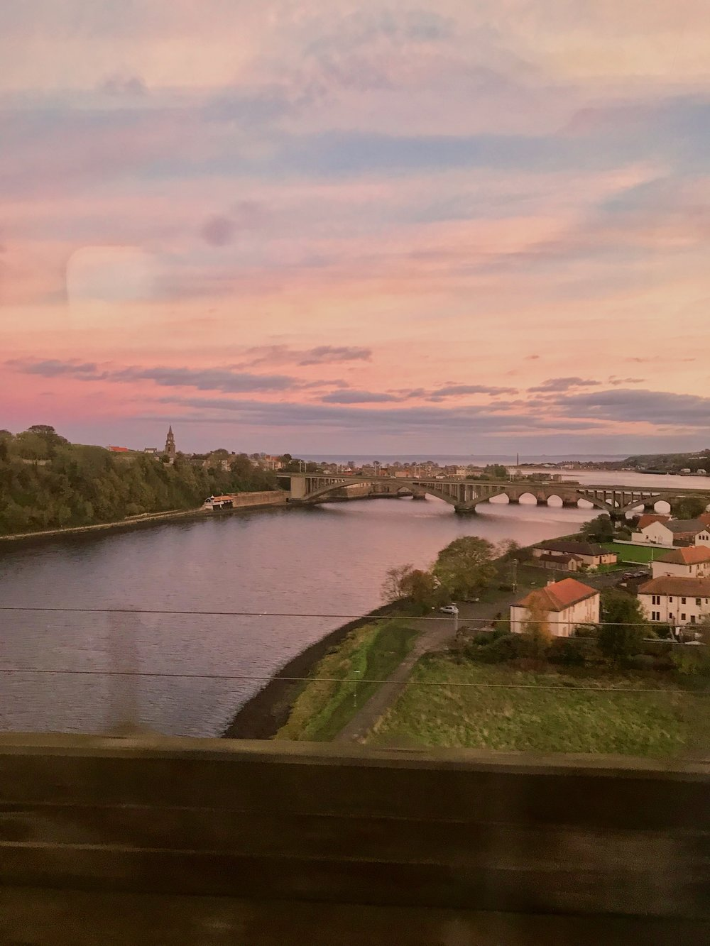 The train wasn't all bad. This is the view from the window of sunset in Berwick-upon-Tweed.