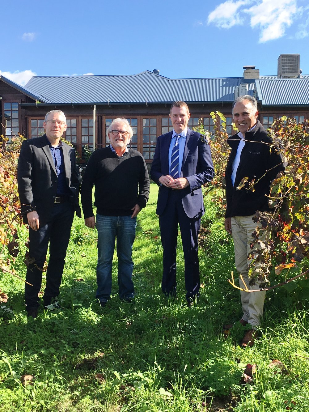 From left to right Larry Jorgensen, CEO of Wines of WA; Barry Scrivenor, owner of Black Swan Winery; MHR Christian Porter; Chris Furtado, Wines of WA Board Member and GM of Voyager Estate in Margaret River.  Photo taken at Black Swan Winery, 8600 West Swan Road, Henley Brook.