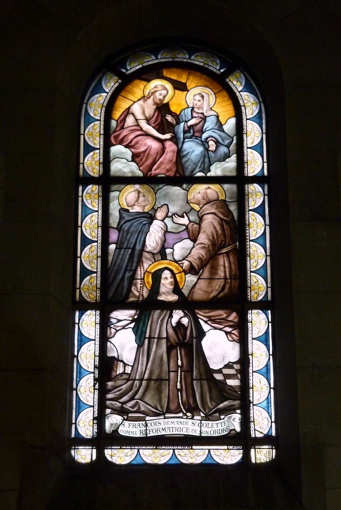 This stained glass window is at Sant Ouen in France, it shows Francis and Dominic (who admittedly was not present) asking the Lord to have Colette reform the Franciscan order.