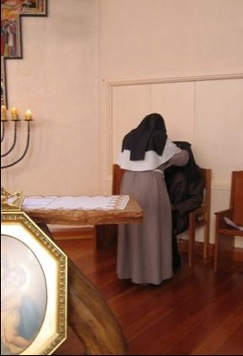 Sister Agatha blessing the Archbishop with the veil of St Colette