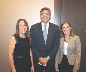 Photo by Cary Shuman - City Manager Tom Ambrosino with Roseann Bongiovanni, executive director of GreenRoots, and Leslie Aldrich, associate director of MGH Center for Community Health Improvement, at the Chamber of Commerce Government Breakfast, where he announced that Chelsea was a recipient of the RWJF Culture of Health Prize.