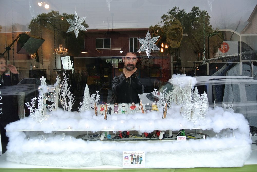 Co-owner Brian Scheyer (pictured, behind Gingerbread runway) and his partner, Jill Giordano masterminded this gingerbread fashion display.