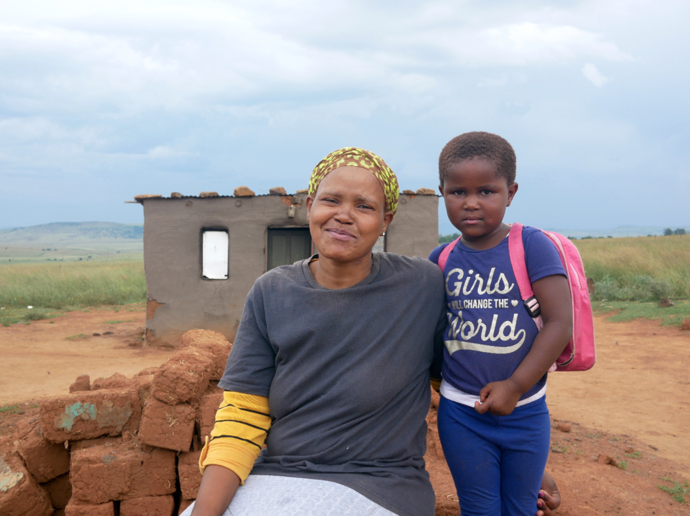 Ayabonga outside her home with her mom.