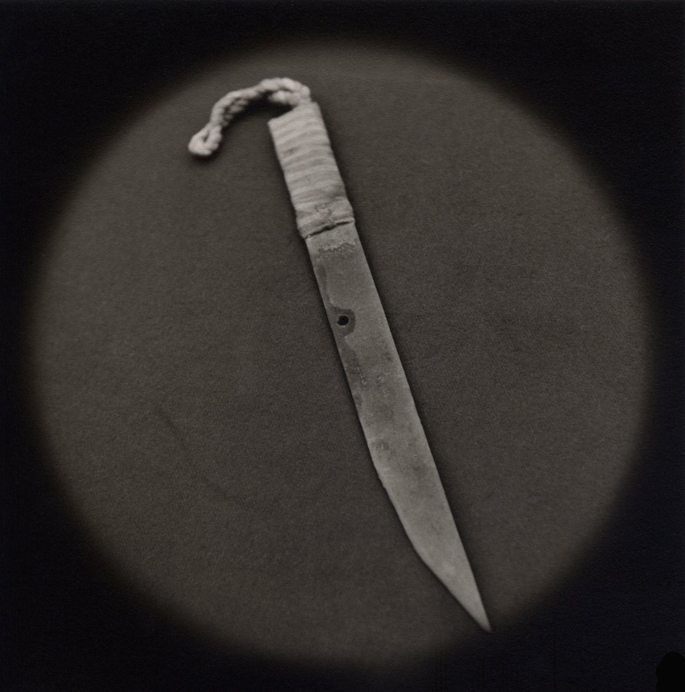 The Lost Steps (Improvised knife made from prison bed frame)  Toned gelatin silver print. 16 x 16 in.
