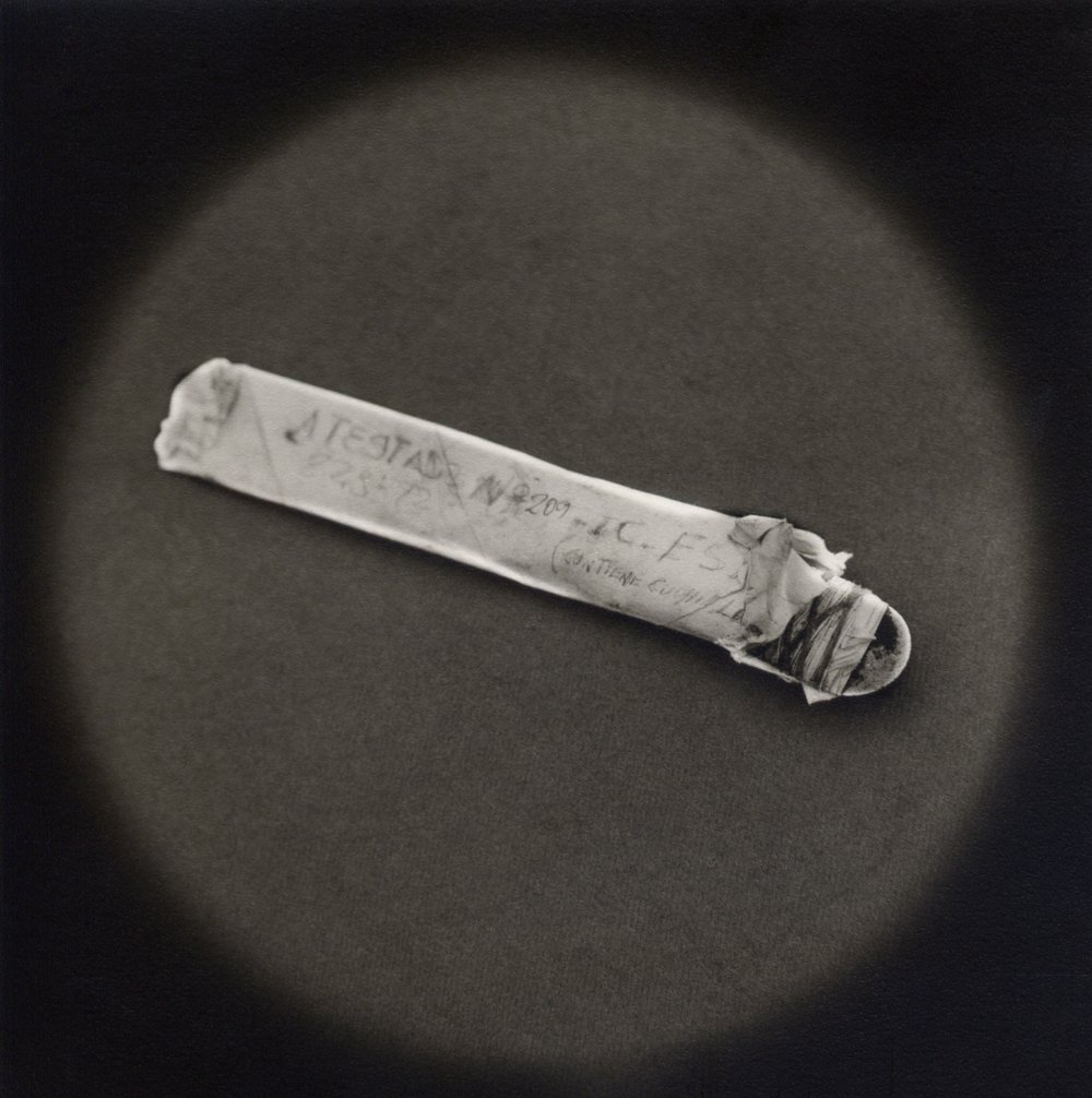 The Lost Steps (Crudely fabricated knife confiscated as evidence)  Toned gelatin silver print. 16 x 16 in.