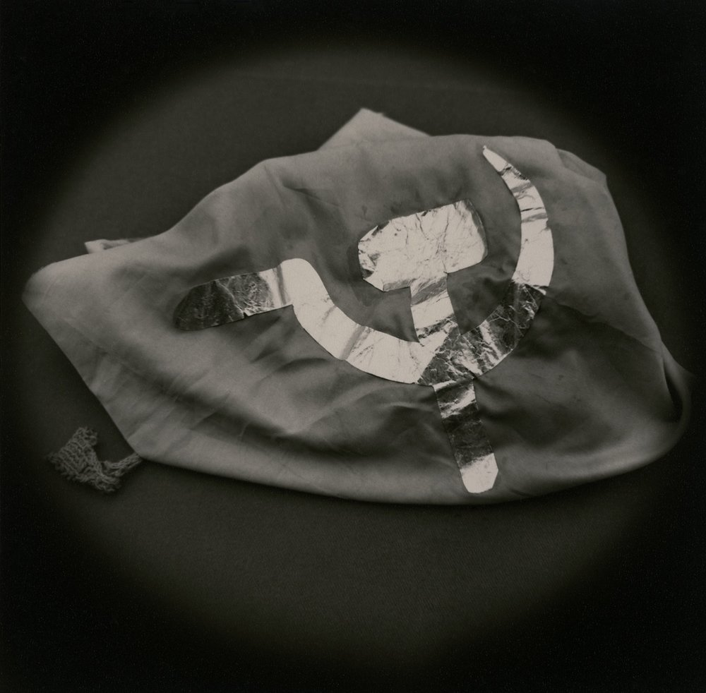 The Lost Steps (Flag confiscated from Shining Path terrorist)  Toned gelatin silver print. 16 x 16 in.