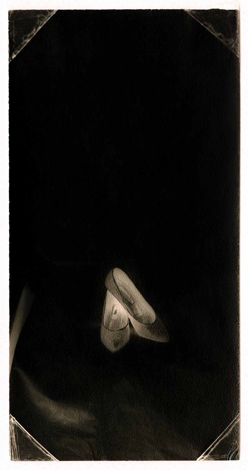 Untitled (Shoes) . Toned gelatin silver print. 3 1/2 x 1 1/2 in.