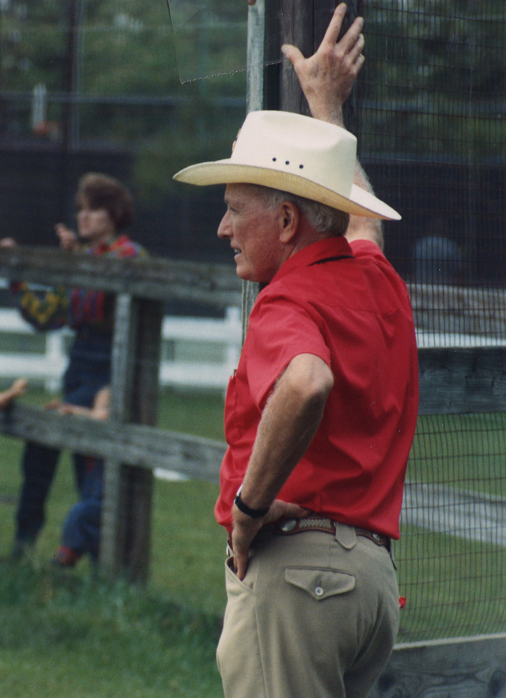 Dr. Cooley watching a softball game at a Texas Heart Institute picnic at Cool Acres.