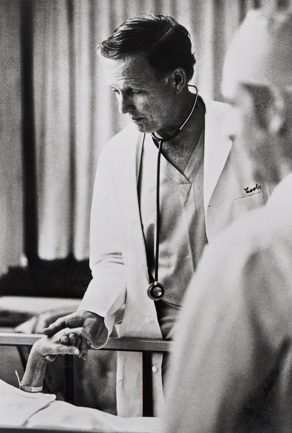 Dr. Cooley with a patient in the ICU during the 1970s.