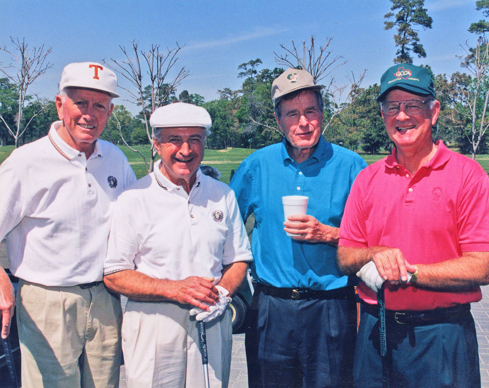 Dr. Cooley, left, with golfing buddies Johnny Ochsner, President George H. W. Bush and James Baker III at the Seniors Golf Tournament, River Oaks Country Club, Houston.