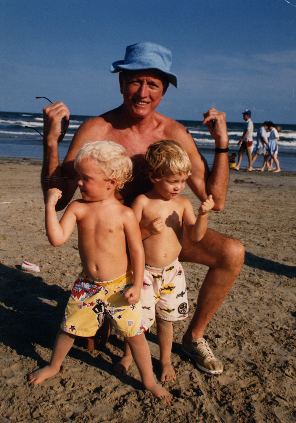 Dr. Cooley with grandsons John Plumb and William Walker on 'Muscle Beach' during a weekend at his Galveston beach house, the 'Cooley Bunkport' in the mid-1980s.